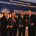 (From left) Michael Fields, Ph.D., dean of the H. Wayne Huizenga School of Business and Entrepreneurship, with the 2010 inductees into the Entrepreneur Hall of Fame: Don Taft, Mitchell Berger and Mike Jackson.