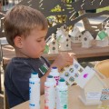 Sam celebrates Earth Day by decorating a bird house.