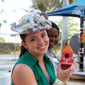 Kathy Sosa, Infant and Toddler Aide, shows off her hat made from recycled materials.