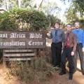 Kevin Straw, Jordan Keck and Ben Funkhouser in front of the facility housing Bible Translation and Literacy Kenya (BTL).
