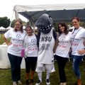 Nova Southeastern University mascot Razor, center, along with NSU student volunteers, supports Special Olympics Broward County at the 2012 Sallarulo's Race for Champions.