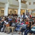 Accepted students gather in the Carl DeSantis Building atrium for President Hanbury's welcome
