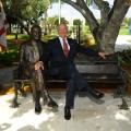 H. Wayne Huizenga Sits on the Newly Unveiled Bench and Statue of Himself