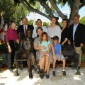 H. Wayne Huizenga and His Family, Spanning Generations, Pose for a Photo Around the Bench