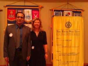 Bahaudin and Shari at Rotary Club - Next to 4 Way Test banner at Weston Club- 8 1 13