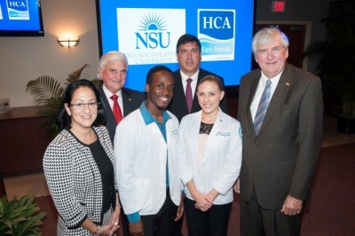 From left to right: Jacqueline Travisano, M.B.A., CPA, NSU executive vice president and COO, George L. Hanbury II, Ph.D., NSU President and CEO, Rolando Norman, NSU 2nd year nursing student and full faculty chair of Nursing Student Association,  Michael G. Joseph, HCA East Florida President and CEO, Zasha Erskine, NSU 2nd year nursing student and president of Nursing Student Association, and Ralph V. Rogers Jr., Ph.D., executive vice president of Academic Affairs.