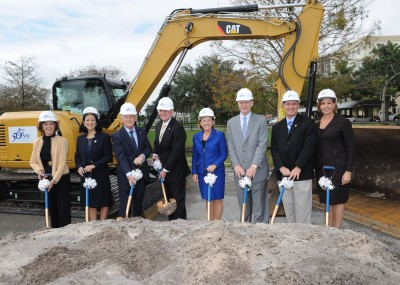 Nova Southeastern University representatives and donors break ground on the $80 million Center for Collaborative Research. Left to right: Nell McMillan Lewis, Ed.D.; Royal Dames of Cancer Research, Inc. and NSU Board of Trustees member; Jacqueline Travisano, M.B.A., C.P.A., NSU executive vice president and chief operating officer; Ron Assaf, NSU Board of Trustees chair; George L. Hanbury II, Ph.D., NSU president; Carol M. Harrison, Royal Dames of Cancer Research, Inc. and NSU Board of Trustees member; George Weaver, Emil Buehler Perpetual Trust; Eric S. Ackerman, Ph.D., dean of NSU's Graduate School for Computer and Information Sciences; Jennifer O'Flannery Anderson, Ph.D., NSU vice president for advancement and community relations