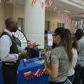 Financial Aid Counselor Cleones Fleurima discusses options with prospective students at the Carnival of Majors.