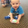 Atticus Collins, son of NSU Professor William Collins, plays with a model brain.