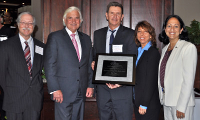 Raymond Ownby (center), M.D., Ph.D., M.B.A., professor and chair of NSU's College of Osteopathic Medicine (COM) Department of Psychiatry and Behavioral Medicine, received the 3rd Annual Provost's Research and Scholarship Award in 2013 and was joined by (left to right) Gary Margules, Sc.D., vice president for research and technology transfer; George L. Hanbury II, Ph.D., president and CEO; Robin Jacobs, Ph.D., M.S.W., College of Osteopathic Medicine; and Jacqueline Travisano, M.B.A., C.P.A., executive vice president and COO.