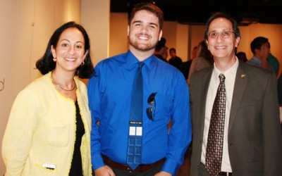 Honors student Josh Whitehurst with Jacqueline Travisano, M.B.A., CPA, and Don Rosenblum, Ph.D., dean of the Farquhar College of Arts and Sciences, at a reception for merit-scholarship recipients on Aug. 26