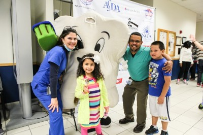 Aline Medina, D.D.S. (right), first year pediatric dental resident at NSU's College of Dental Medicine, welcomes a young girl to Give Kids a Smile Day