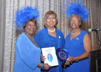 Pictured left to right: Sorority Member Annie Baker, Awardee, Lois Lee, and President, Cora Coleman Portee.
