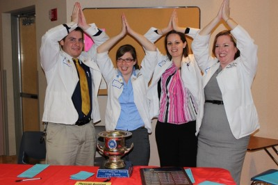 Fins up! 1st year Physician's Assistant Ft. Meyers students accepting the Ethics Bowl Award with NSU Pride (from left to right): Eric Bertha, Alia Rawlins, Nikki Iozzia and Heather Robbins.