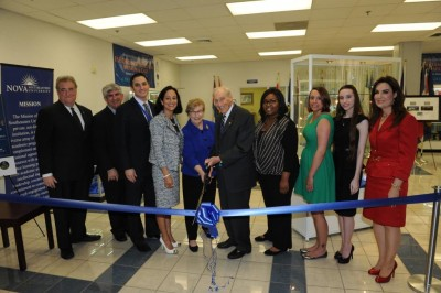 Cutting the ribbon at the Fischler School of Education Distance Education Museum & Café were (l-r) FSE Interim Dean Ronald Chenail, Ph.D.; Museum organizer and FSE faculty member and Student Government Association  Adviser Daniel Markarian, Ed.D.; FSE Associate Dean Jamie Manburg, Ed.D.; NSU Executive Vice President and Chief Operating Officer Jacqueline A. Travisano; Mrs. Shirley Fischler; Abraham S. Fischler, Ed.D.; FSE SGA Treasurer Sabrina Edwards; FSE SGA Board Member Miriam Musco; FSE SGA and Kappa Delta Pi President Nova Lishon-Savarino; and FSE Associate Dean Tara Saltzman, Ph.D.