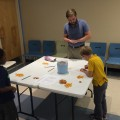 Jeffrey Lyons, Ph.D., assistant professor at the Halmos College of Natural Sciences and Oceanography, works with children at a STEM Programs for Children session at the Alvin Sherman Library.