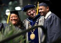 Karen Reinford-Perez and her son, Richard Perez, celebrate graduation with President George Hanbury.