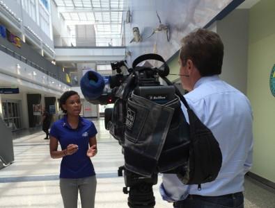 NBC 6 reporter Ari Odzer interviews NSU student Schae Maynard