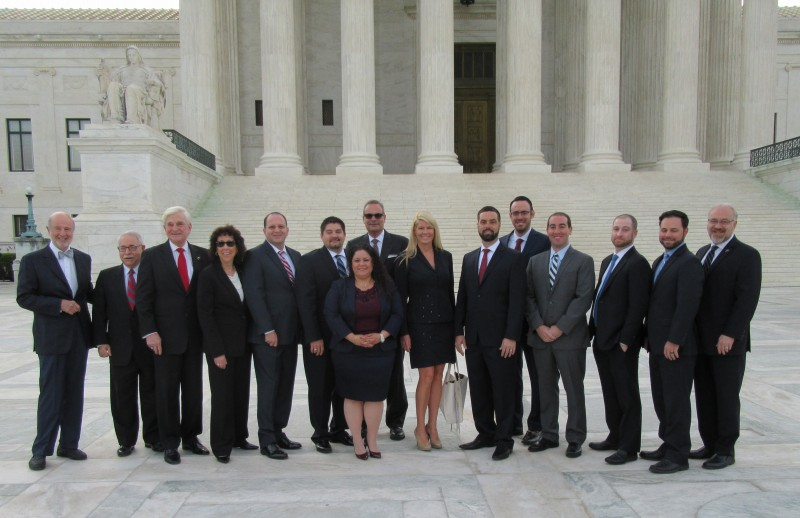 From l. to r.) Bruce Rogow, NSU Law Professor Emeritus; Martin Press, NSU Trustee; NSU President Dr. George L. Hanbury, and (far right) Jon Garon, dean of the Shepard Broad College of Law, with newly admitted to Supreme Court lawyers Lisa Goldberg, Joseph Natiello, Nathaniel Flinchbaugh, Tara Campion, Steven Farbman, Jane West, Michael Pascucci, Michael Ehren, Adam Schloss, Benjamin Lopatin and Joshua Eggnatz. Emmanuela Charles, was also admitted but is not pictured.