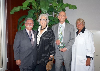From left: Anthony J. Silvagni, D.O., Pharm.D., M.Sc., FACOFP Dist., Dean Emeritus and Director of International and Interprofessional Medicine; Eleanore and Leonard Levy; and Elaine M. Wallace, D.O., M.S., M.S., M.S., NSU-COM Dean