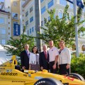 Marc Cannon, Chief Marketing Officer and Senior Vice President, AutoNation; Dr. Jacqueline A. Travisano, Chief Operating Officer and Executive Vice President, Nova Southeastern University (NSU); Ronald G. Assaf, Chair, NSU Board of Trustees; Ryan Hunter-Reay, Indianapolis 500® Champion and Founder of Racing for Cancer; Dr. Jennifer O'Flannery Anderson, NSU Vice President for Advancement and Community Relations; with the car in which Hunter-Reay won the 2014 Indianapolis 500®