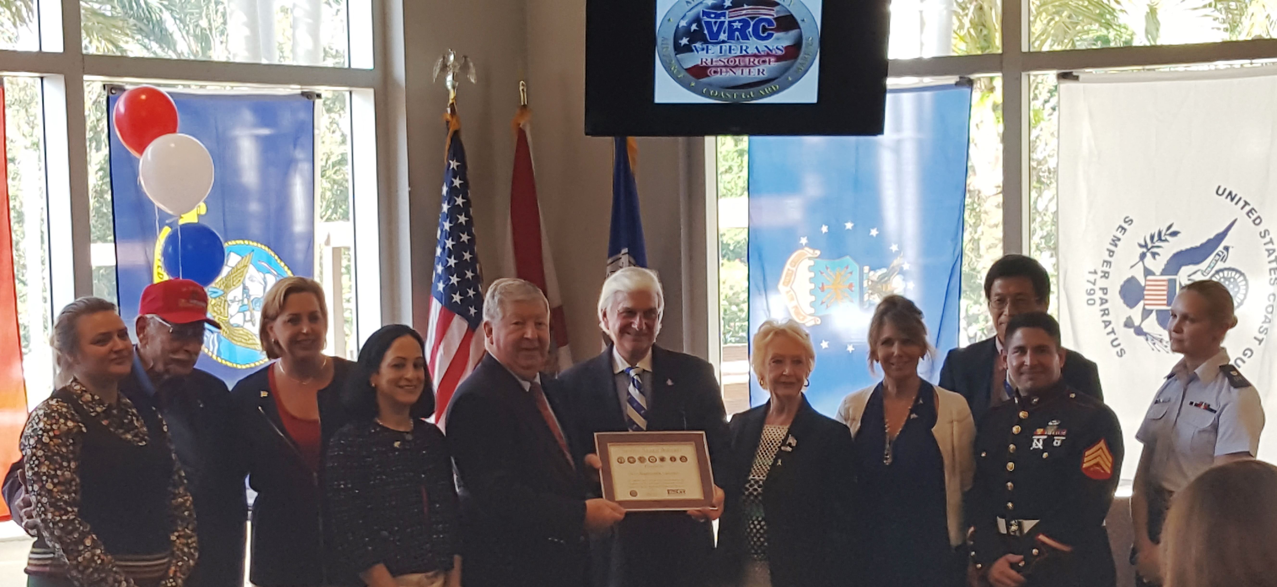 NSU President Dr. George Hanbury, center, poses with guests and officials to receive the Seven Seals Award.)