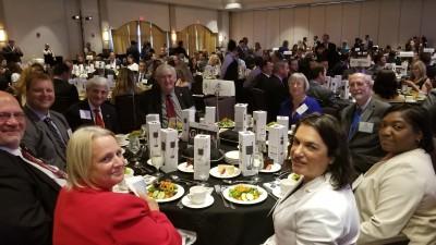 Award winner Derek Burkholder, Ph.D. (2nd from left) and NSU's table