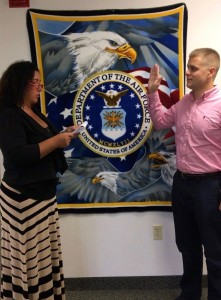 : Assistant Professor Tammy Kushner, Psy.D., administers the oath of office to Stephen Grabner.