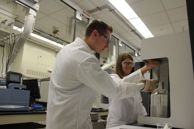 Jacilynn Brant, Ph.D. and her student Jake Bence conducting research at Oak Ridge National Laboratory.