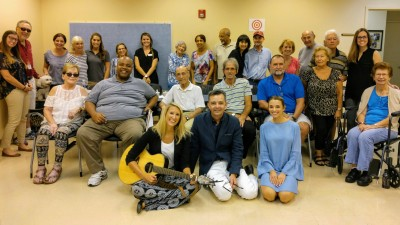 From the left is Bree Gordon (pictured with guitar) and in the center, is Fred DiCarlo, with the members of NSU's aphasia groups-with graduate student clinicians, faculty, and guest music therapist, gathered for a music event, which culminated the summer 2017 semester.