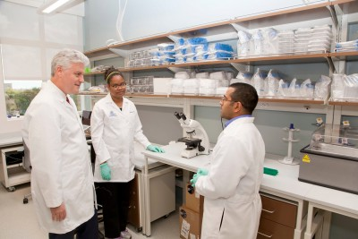 Research will be emphasized in the NSU College of Allopathic Medicine's innovative curriculum. Pictured: Johannes W. Vieweg, M.D., FACS, founding dean, speaks with Julia James, Ph.D, post-doctoral researcher, and Ron Thomas, B.Sc., research assistant, in the NSU Cell Therapy Institute laboratory.