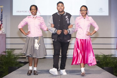 "The African Presence opening reception featured Ambar De Los Santos, Raphael Walters and Lorena De Los Santos modeling 1950s clothing during the ""Styles through the Decades"" fashion show."