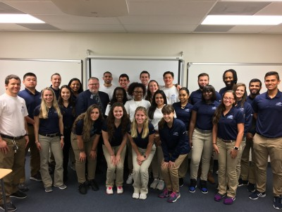 In the first, second, and third rows are all Levels of NSU athletic training students taking a picture with NATA President Scott Sailor (from the left, second row, third person).