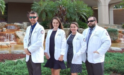 From left, NSU physician students, Jonathan Nusbaum, Kassidy Anthony, Erin Diskin, and Perry Crawford in front of Fort Myers City Hall.