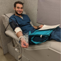 Class President Kevin Luks donating blood